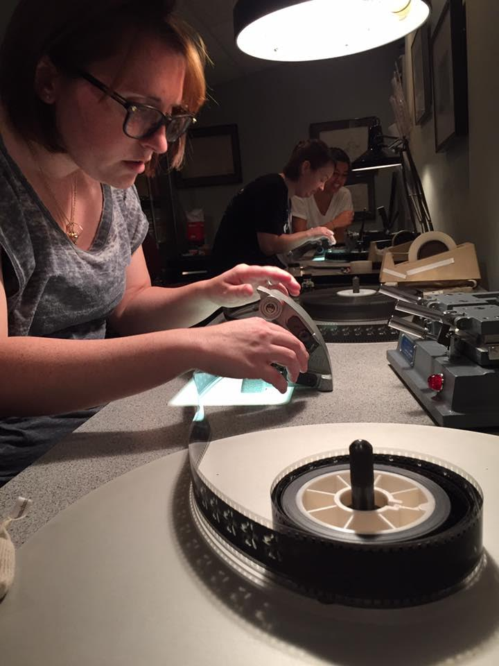 iSchool MLIS student Sarah Smith working on a film cement splice.