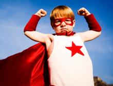 child in super hero costume