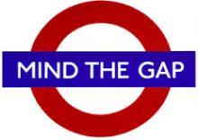 London Underground symbol, text Mind the Gap