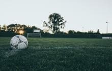 photo of soccer ball left on field