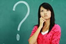 Question mark on chalkboard, woman