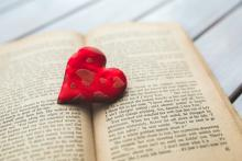 plush red heart on an open book