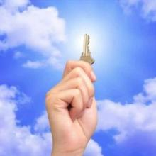fist in the clouds holding a key