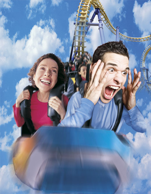 riders on rollercoaster