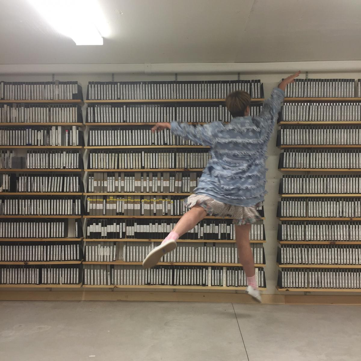 iSchool alumna Brittany Austin at the Jacob's Pillow archives.