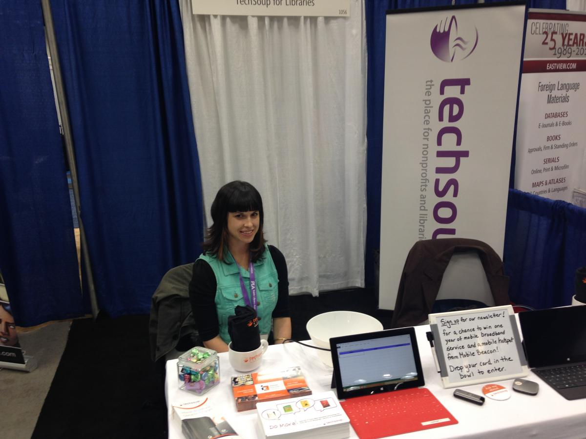 iSchool Alumna Ginny Mies works TechSoup's booth at the 2014 PLA conference.