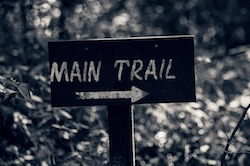 sign pointing to main trail