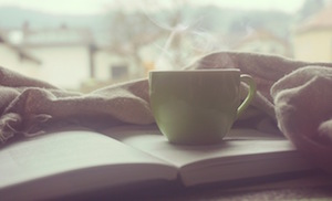 steaming mug on an open book