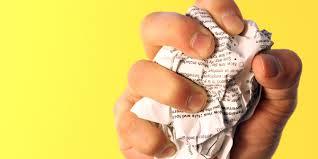 hand crunching up paper