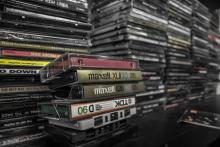 photo of stacks of cassette tapes and cds