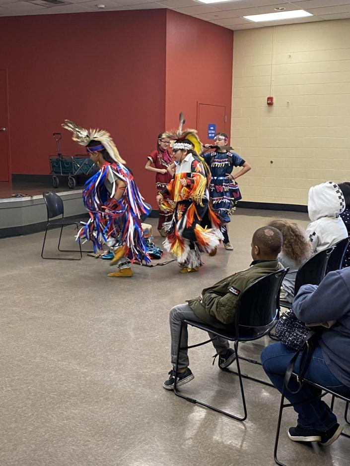 Native American Children performing a dance.